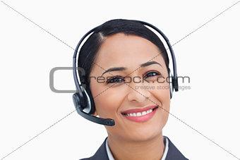 Close up of smiling call center agent