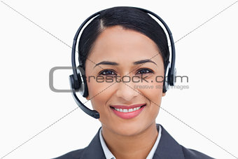 Close up of friendly smiling call center agent