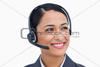 Close up of smiling call center agent looking to the side