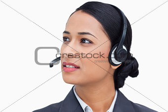 Close up of talking call center agent looking to the side