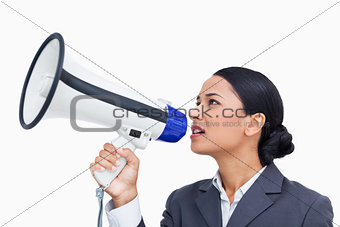 Close up side view of saleswoman using megaphone