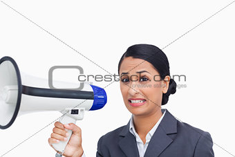 Close up of afraid saleswoman with megaphone