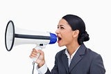 Close up of saleswoman yelling through megaphone