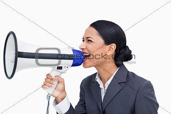 Close up of saleswoman shouting through megaphone