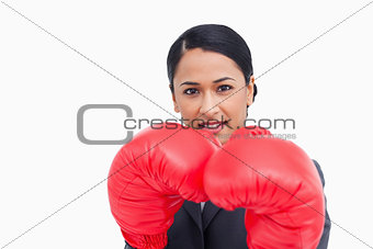 Close up of confident saleswoman with boxing gloves