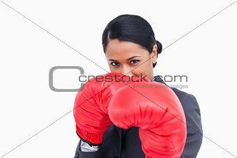 Close up of aggressive saleswoman with boxing gloves