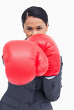 Close up of saleswoman with boxing gloves attacking