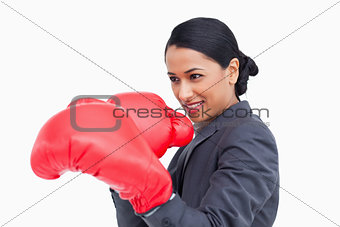 Close up side view of saleswoman with boxing gloves