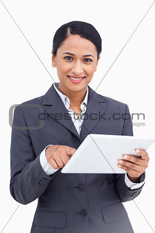 Close up of saleswoman using touch screen computer