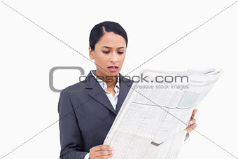 Close up of saleswoman reading news paper