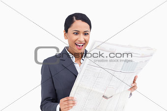 Close up of surprised saleswoman reading the news paper