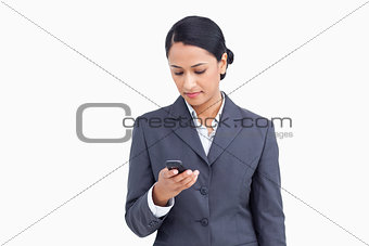 Close up of saleswoman writing text message