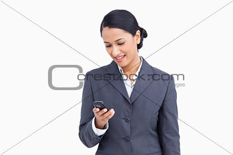 Close up of smiling saleswoman reading text message