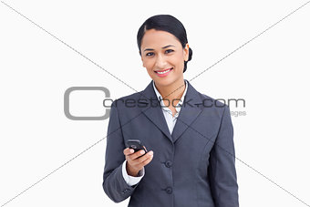 Close up of smiling saleswoman holding cellphone