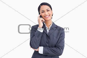 Close up of saleswoman on her mobile phone