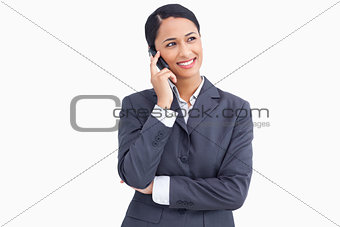 Close up of smiling saleswoman in telephone conversation