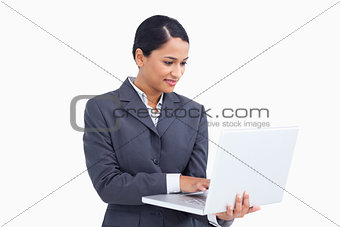 Close up of saleswoman using her laptop