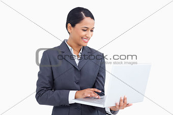 Close up of smiling saleswoman using her laptop