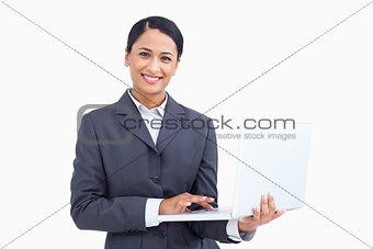 Close up of smiling saleswoman with her notebook