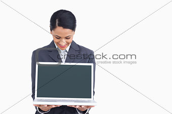 Close up of saleswoman showing notebook screen