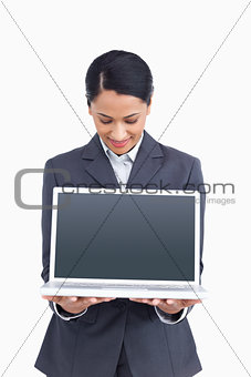 Close up of saleswoman presenting screen of her laptop