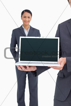 Close up of laptop being presented by salesteam
