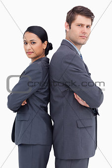 Close up of confident salesteam standing back to back
