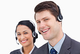 Close up of smiling call center employees