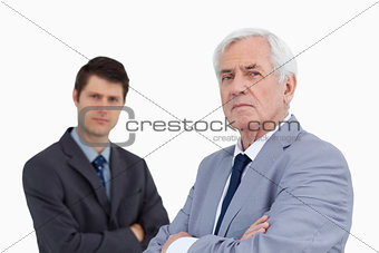 Close up of businessmen with arms folded