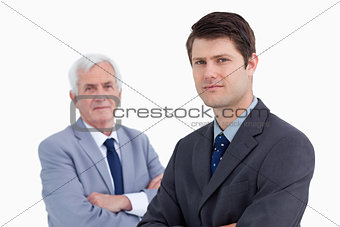 Close up of young businessman with his mentor behind him