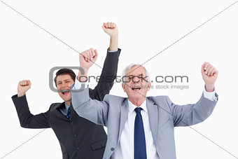 Close up of cheering businessmen