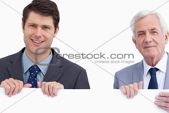 Close up of businessman holding blank sign