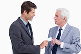 Close up of businessman giving business card to trades partner