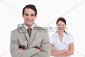 Smiling businessteam with arms crossed
