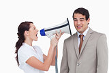 Saleswoman with megaphone yelling at colleague