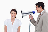 Salesman yelling at colleague with megaphone