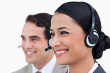 Close up side view of smiling call center agents