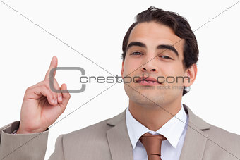 Close up of salesman pointing up