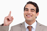 Close up of smiling salesman pointing up