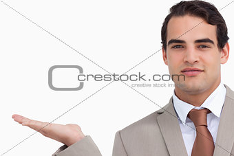 Close up of salesman holding palm up
