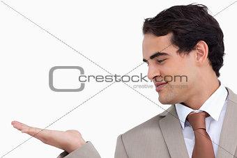 Close up of salesman looking at his palm