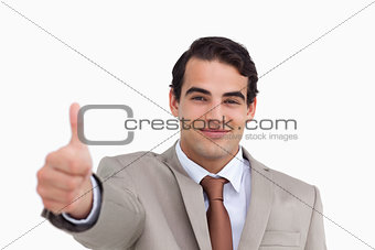 Close up of young salesman giving thumb up