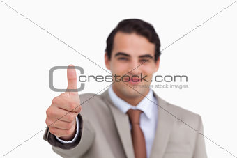 Close up of thumb up being given by salesman