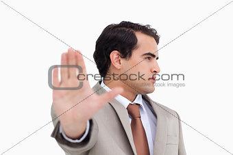 Close up of salesman signalizing stop