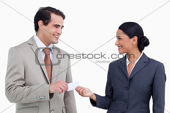 Smiling sales partner exchanging business cards