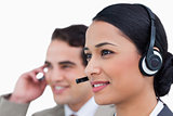 Close up side view of call center agents