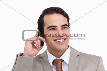 Close up of smiling salesman on his cellphone
