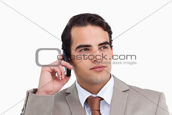 Close up of serious salesman on his cellphone