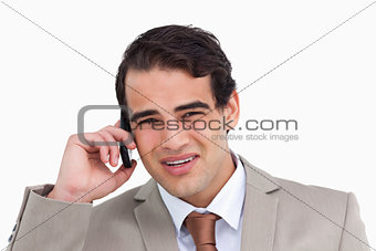 Close up of annoyed young salesman on his cellphone