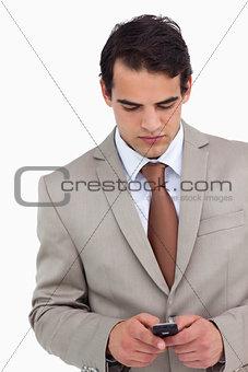 Close up of salesman writing text message